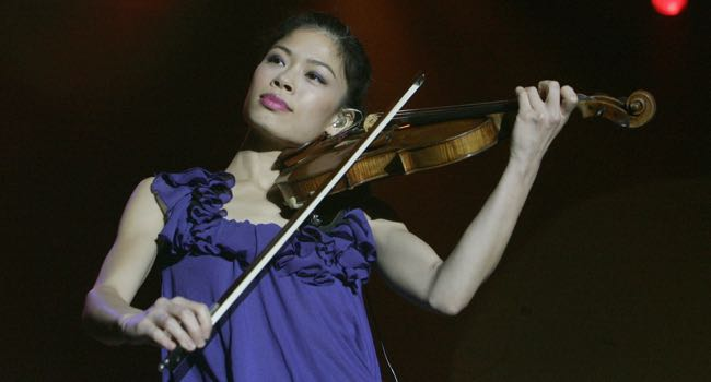 A file photograph shows violinist Vanessa Mae performing on stage during a concert in Prague