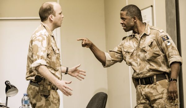 Rory Kinnear as Iago and Adrian Lester as Othello.
